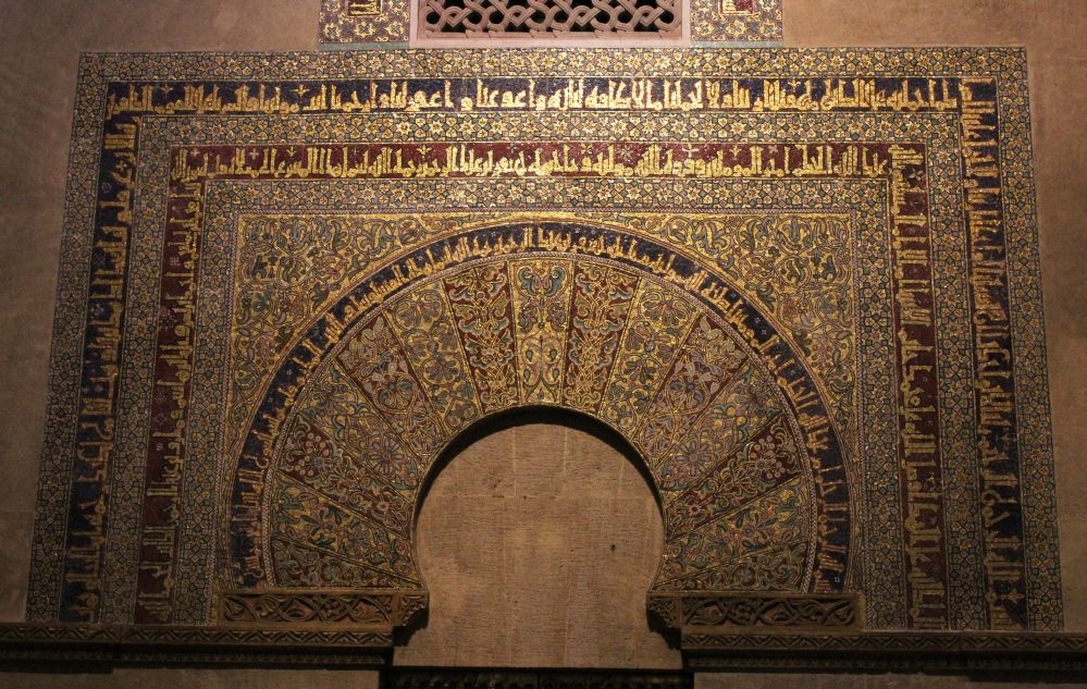 Mihrab of the Mosque of Cordoba decorated with floral patters and Kufi calligraphic friezes.